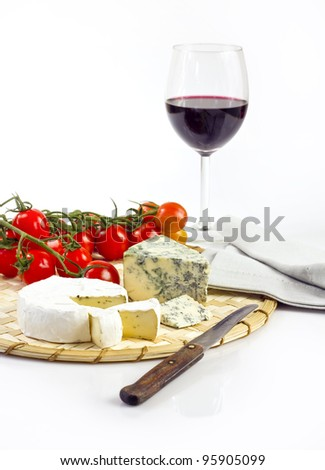 cheese, tomatoes and wine - stock photo