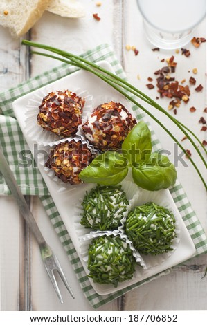 Cheese truffles with chives and pepper - stock photo