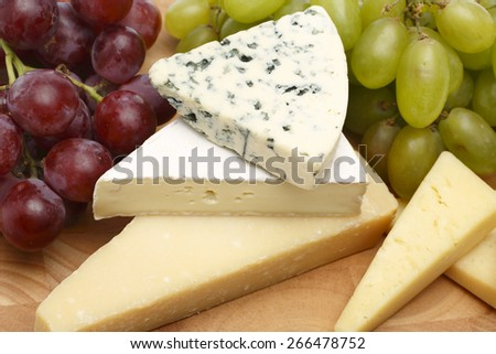 Cheese variation Blue cheese brie and parmesan cheese - stock photo