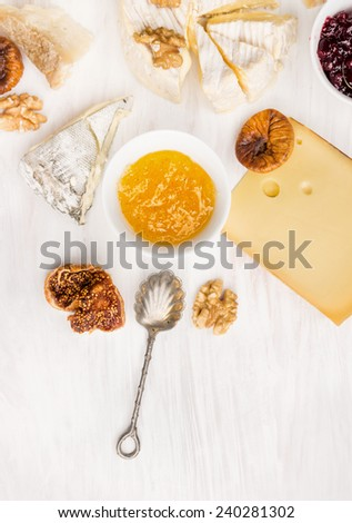 cheese various with Fig mustard sauce on white wooden background - stock photo