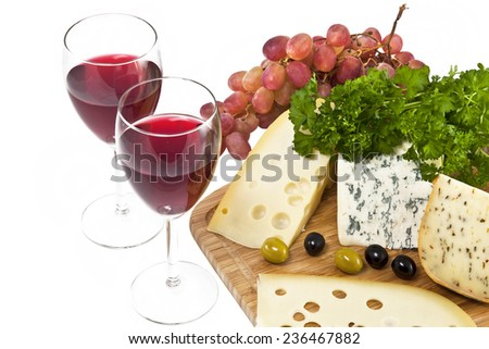 Cheese, wine, grapes, olives and parsley on white background isolated - stock photo