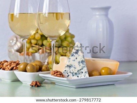 Cheese with fruits on the kitchen table - stock photo