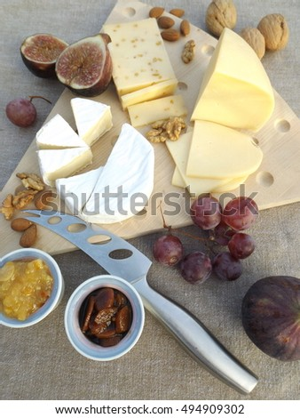 cheeseboard, three cheeses, fruits, nuts, carrot-apricot chutney, citrus marmalade