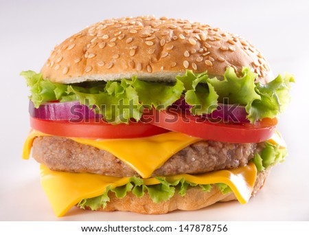 Cheeseburger. Cheeseburger on light background. Vintage Cheeseburger. Home made burger. Fastfood meal. Pub burger. Delicious burger. Gourmet Cheeseburger. Cheeseburger isolated. Rustic Cheeseburger.