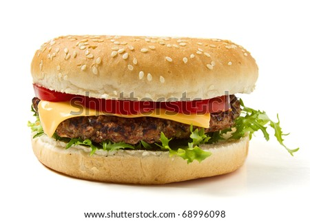 Cheeseburger in sesame seeded bun isolated on white.