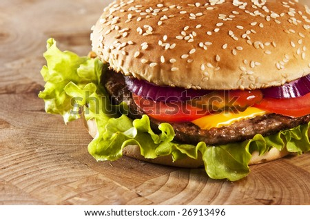 Cheeseburger with onions tomato and ketchup - stock photo