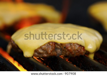 Cheeseburgers on the Grill - stock photo