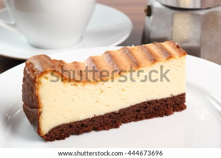 Cheesecake and coffee cup. Macro.