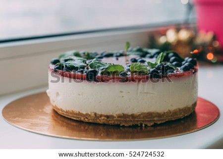 cheesecake, Blueberry cheesecake on wooden plate with blueberries