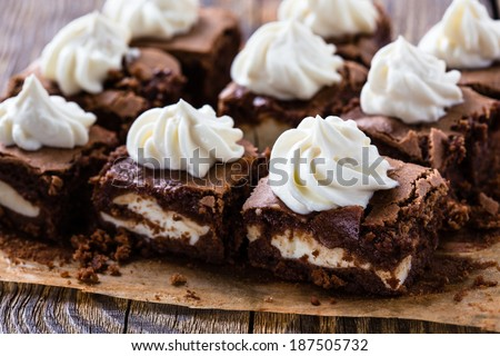 Cheesecake brownies with cream cheese swirled frosting - stock photo