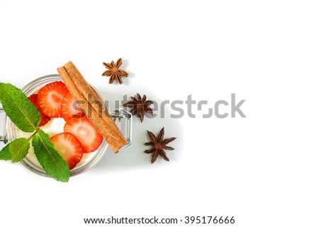 Cheesecake in a jar with Strawberries and  cinnamon, star anise. Top view - stock photo