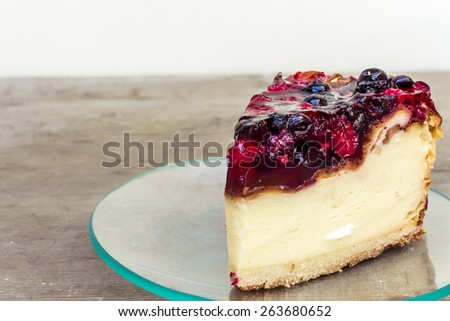 Cheesecake on a Transparent Plate - stock photo