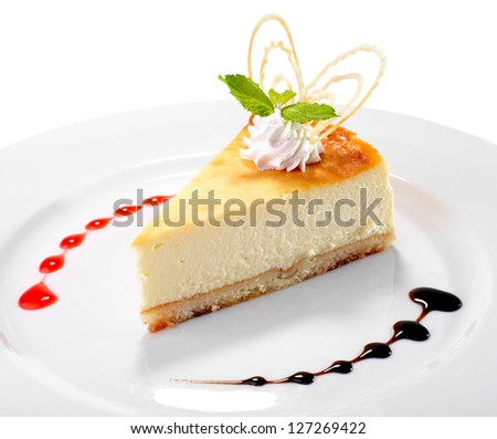 cheesecake on the plate on white background - stock photo
