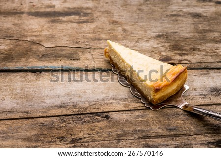 Cheesecake slice on wooden background. Recipe and menu dessert background - stock photo