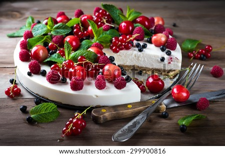 Cheesecake with berries and mint, summer dessert. - stock photo