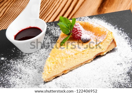 Cheesecake with Berries Sauce and Green Mint - stock photo