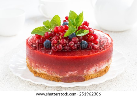cheesecake with berry jelly on a plate, close-up - stock photo
