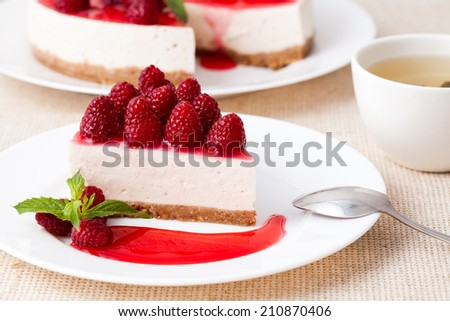 Cheesecake with berry sauce and green tea - stock photo