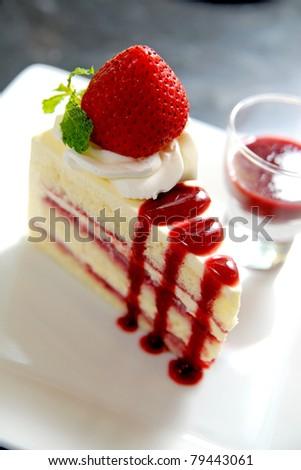 Cheesecake with fresh strawberries - stock photo