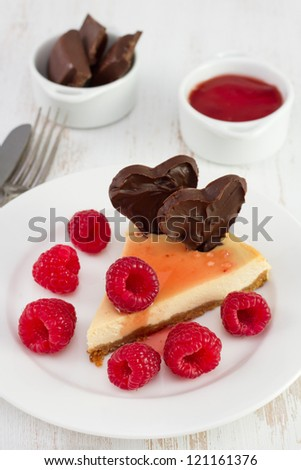 cheesecake with raspberries, jam and chocolate hearts