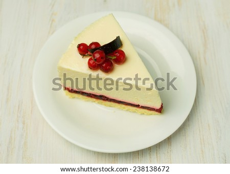 cheesecake with red currant close-up - stock photo