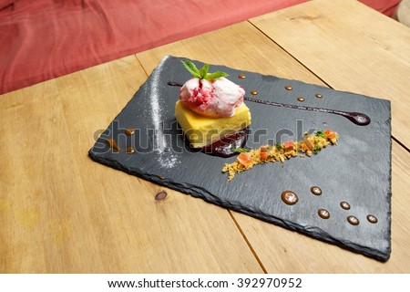 Cheesecake with red fruit and ice cream. - stock photo