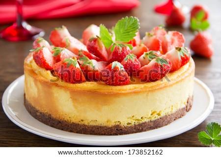 Cheesecake with strawberries. - stock photo