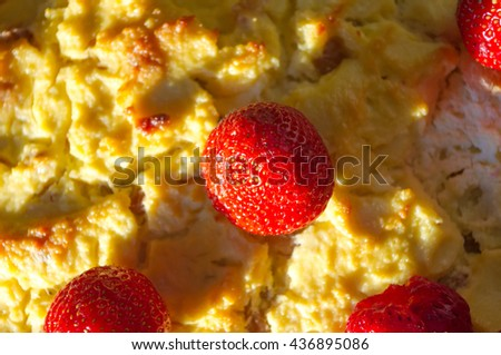 cheesecake with strawberries on a red napkin, selective focus