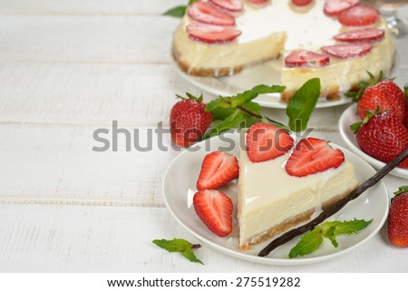 Cheesecake with strawberries on a white background - stock photo