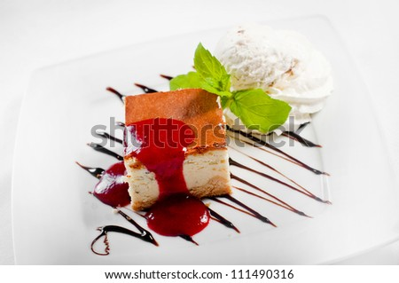 Cheesecake with whipped cream on white. - stock photo