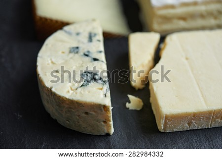 cheeses chops on black background. shallow dof - stock photo