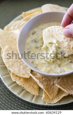 Cheesy Artichoke Dip Served with Tortilla Chips - stock photo