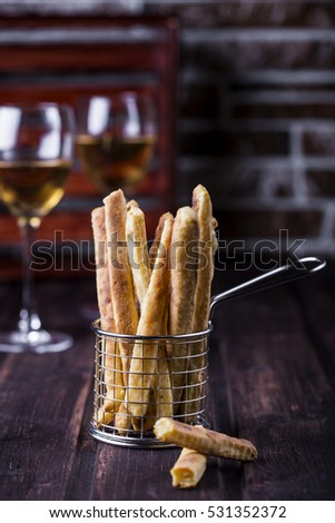 cheesy breadsticks with chili and thyme in a basket