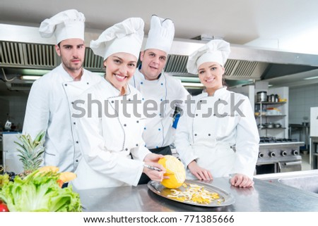 Chef and kitchen staff. Teamwork