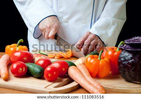 Chef chopping vegetables, horizontal shot - stock photo