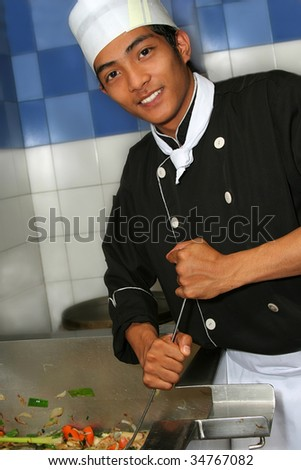 chef cooking at kitchen - stock photo