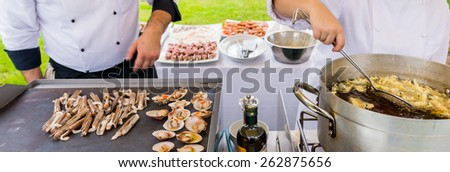 chef cooking detail, in catering service