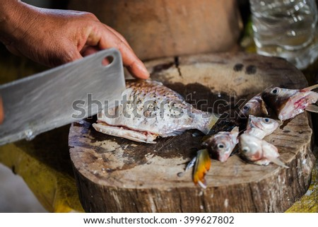 Chef cutting fish before cooking