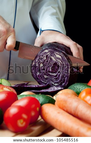 Chef cutting red cabbage, close-up - stock photo