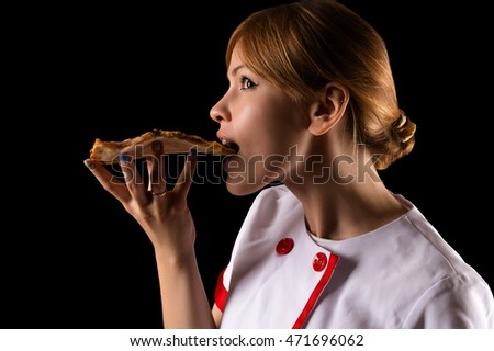 chef eating a slice of pizza