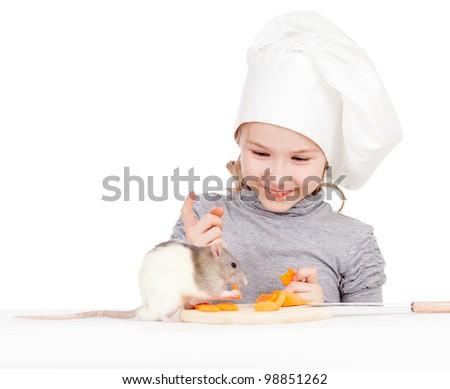 Chef girl preparing healthy food. Helper rat are sitting near. - stock photo