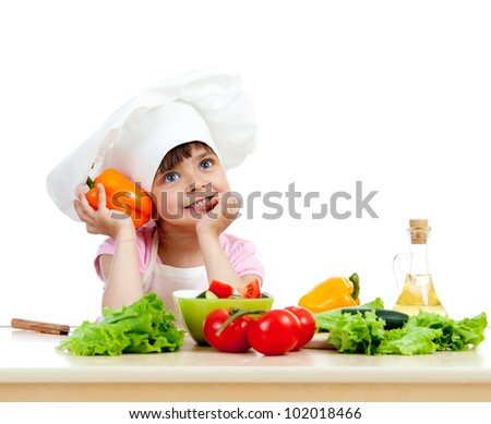 Chef girl preparing healthy food vegetable salad over white background - stock photo