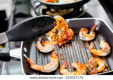 chef grilled shrimps steak in a pan - stock photo