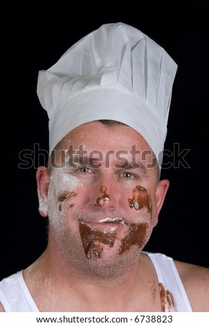 Chef grins after he attempted to cook his first chocolate and vanilla pastry item - stock photo