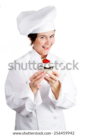 Chef holding a delicious cheesecake tart.  Isolated on white.   - stock photo