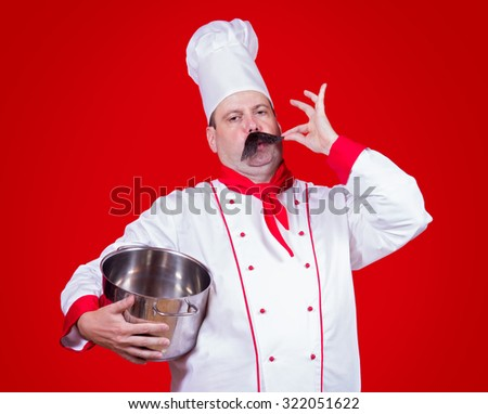 chef holding a pot with gesture okay - stock photo