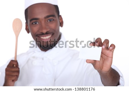 Chef holding business card - stock photo