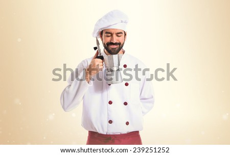 Chef holding coffe pot - stock photo