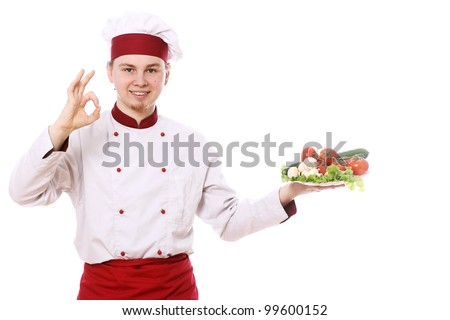 Chef holding plate with vegetables over white background - stock photo
