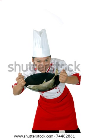chef holding raw fish on a frying pan isolated on white background - stock photo